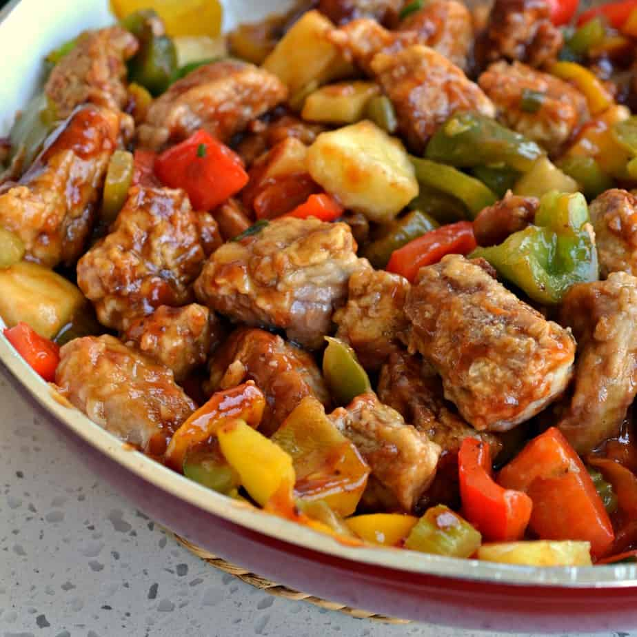 Crispy breaded pan fried pork tenderloin bites combined with sweet bell peppers and pineapple in a ginger Asian sauce.