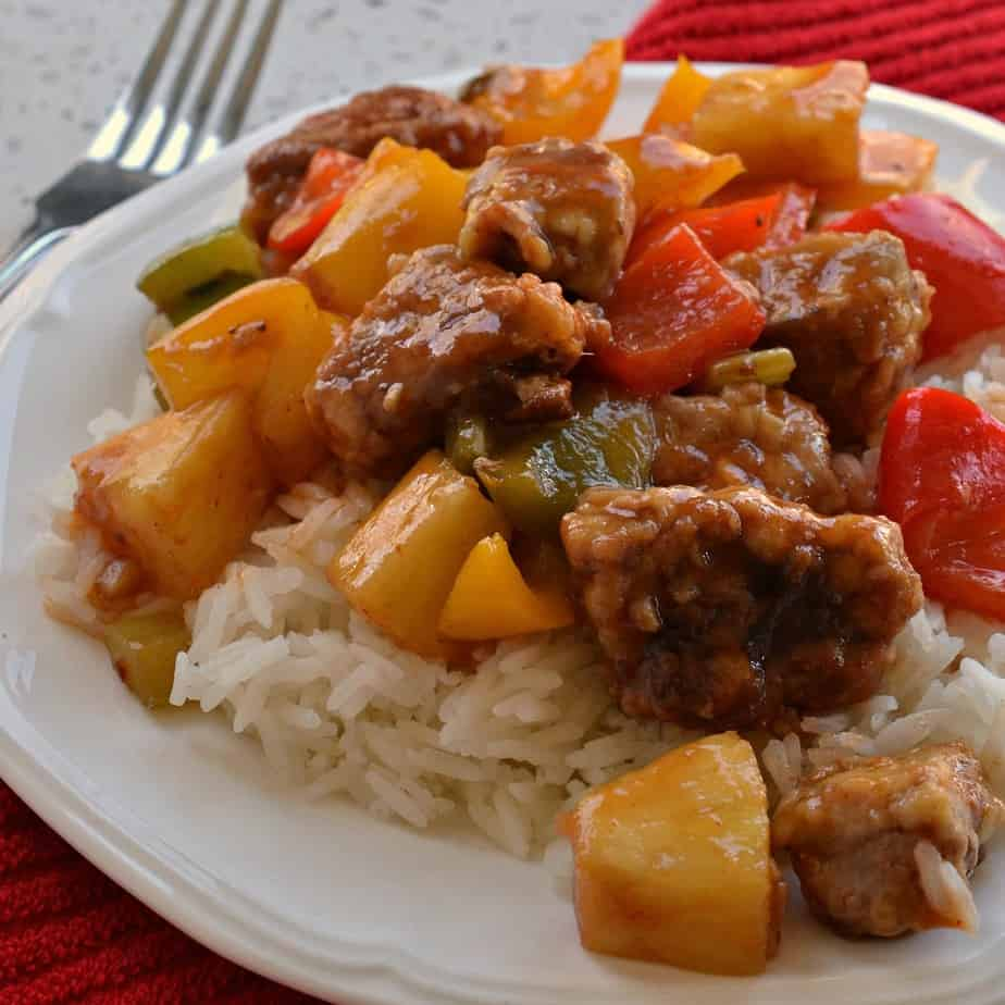 Crispy breaded pan fried pork tenderloin bites combined with sweet bell peppers and pineapple in a tangy ginger Asian sauce.