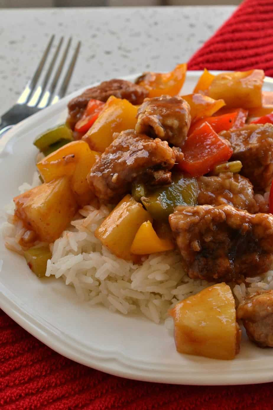 This Sweet Sour Pork brings crispy fried pork together with garlic, celery, sweet bell peppers and pineapple.