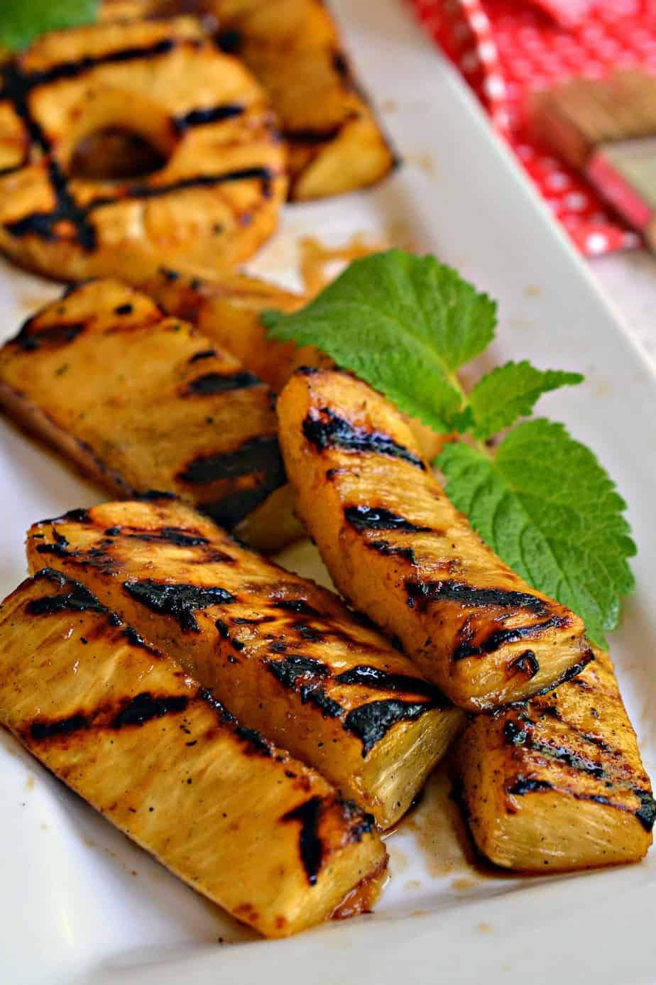 Mouthwatering Grilled Pineapple is marinated in four easy ingredients for thirty minutes and then grilled to perfection.
