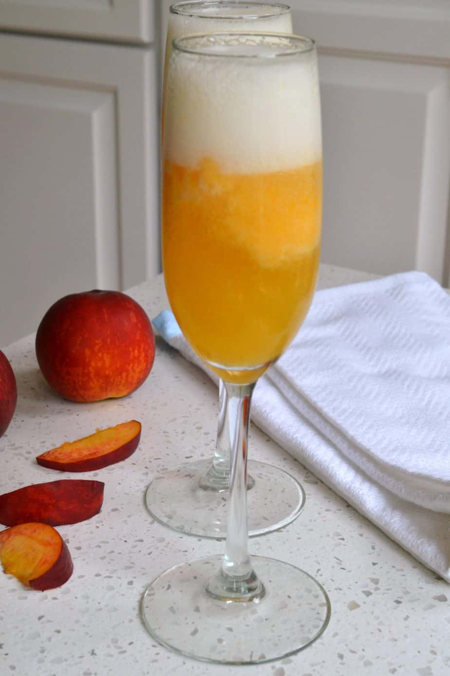 This delectable Peach Bellini is made with fresh or frozen peaches and is the ultimate party drink.