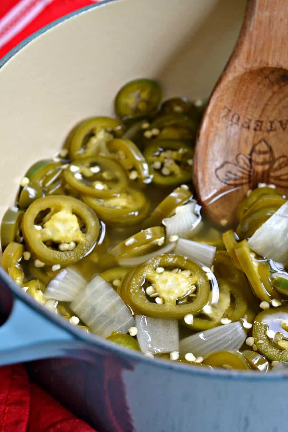 Easy Pickled Jalapenos are slightly sweet tame peppers perfect for snacking, sandwiches, burgers and adding to recipes.
