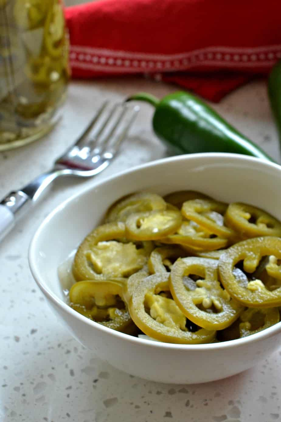 Delicious and easy Pickled Jalapeno Peppers that come together in less than fifteen minutes.