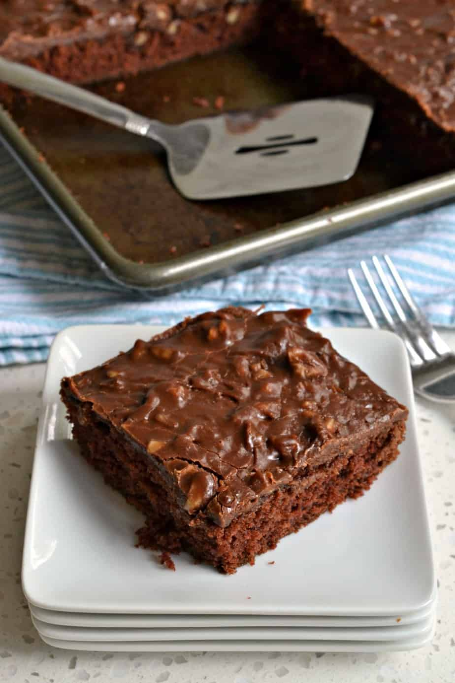 An easy moist chocolate cake baked in a jelly roll pan and topped with a luscious chocolate fudge frosting.