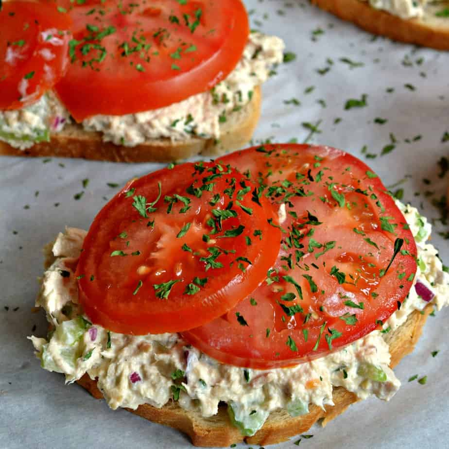This family friendly Tuna Melt is a an open faced sandwich with creamy tuna salad, tomatoes and tasty cheddar cheese.