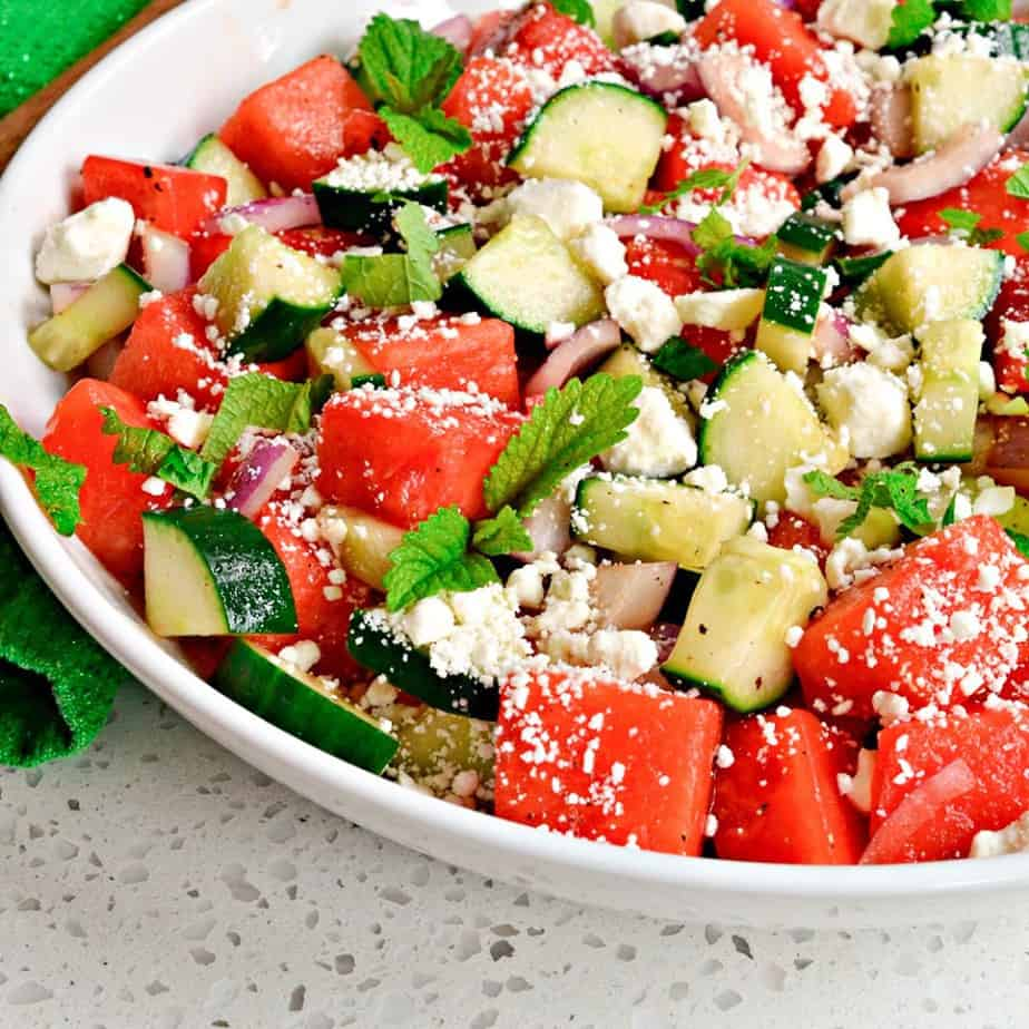 This Watermelon Salad brings the unique flavors of cucumber, feta cheese, sweet red onion, mint and watermelon together.