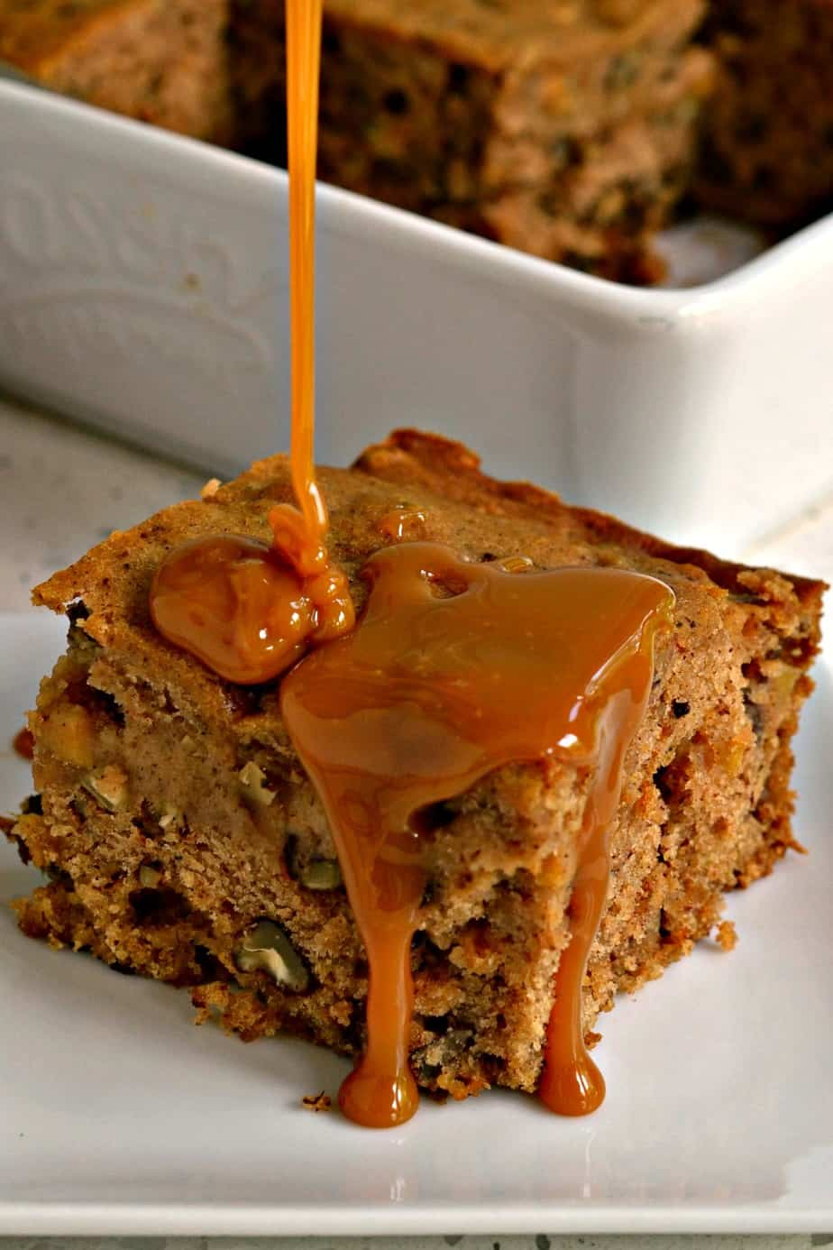 This delicious moist Applesauce Cake is topped with a sweet caramel sauce.