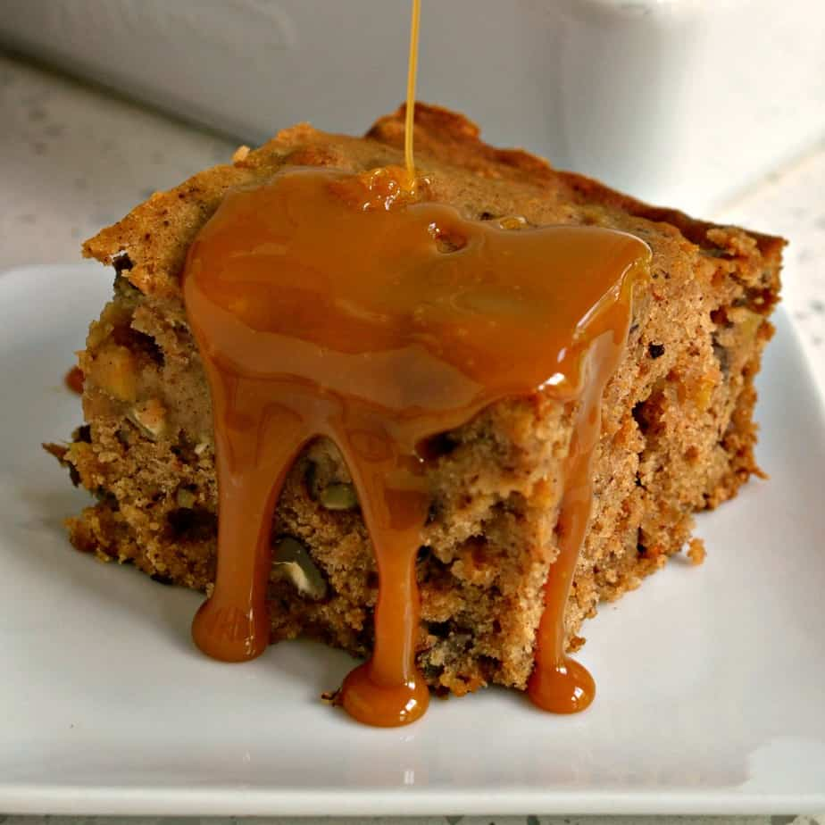 This delicious moist Applesauce Cake is made with crisp apples, buttery pecans, raisins and a perfect blend of fall spices.