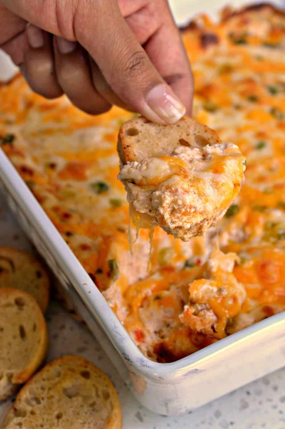 The best ultimate hot Crab Dip made with three different creamy cheeses and a touch of heat and spice.