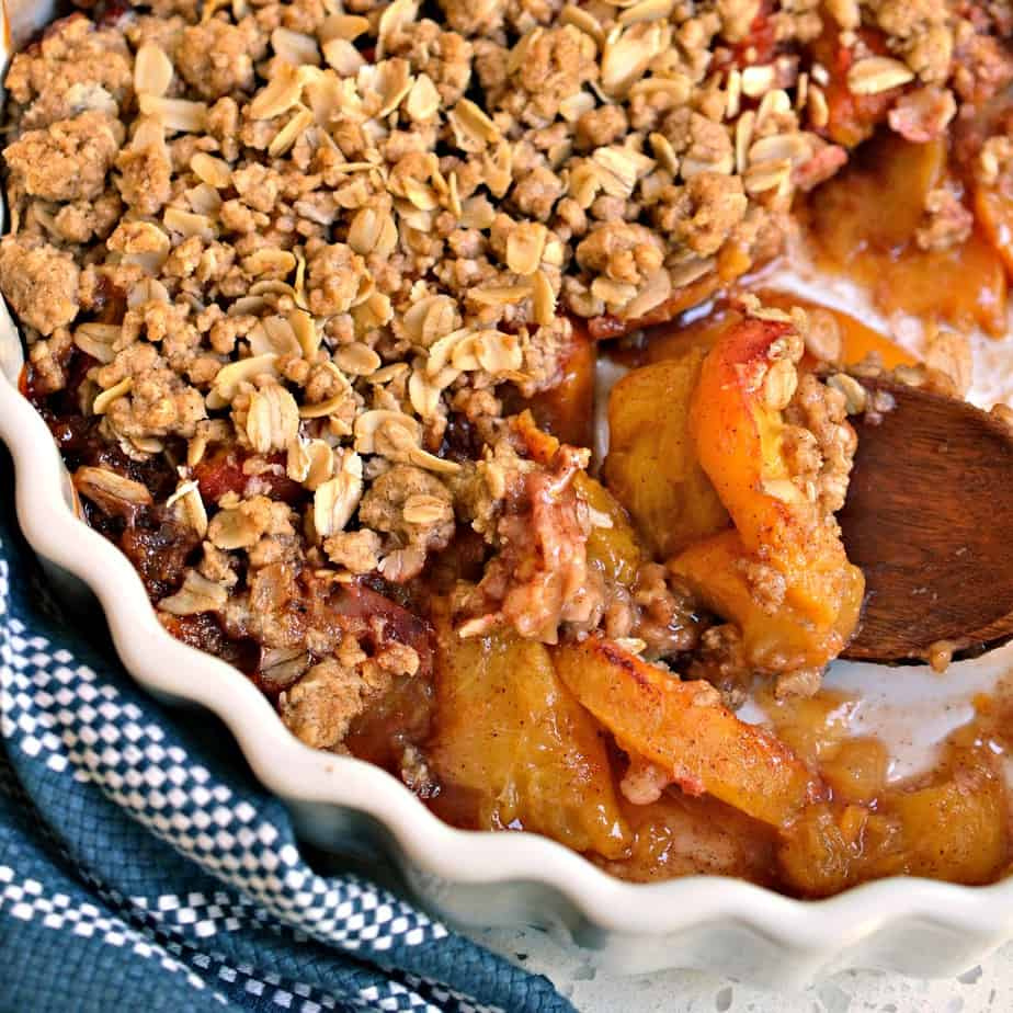 This lightly sweetened fresh peach crisp is topped with a buttery cinnamon oatmeal topping.