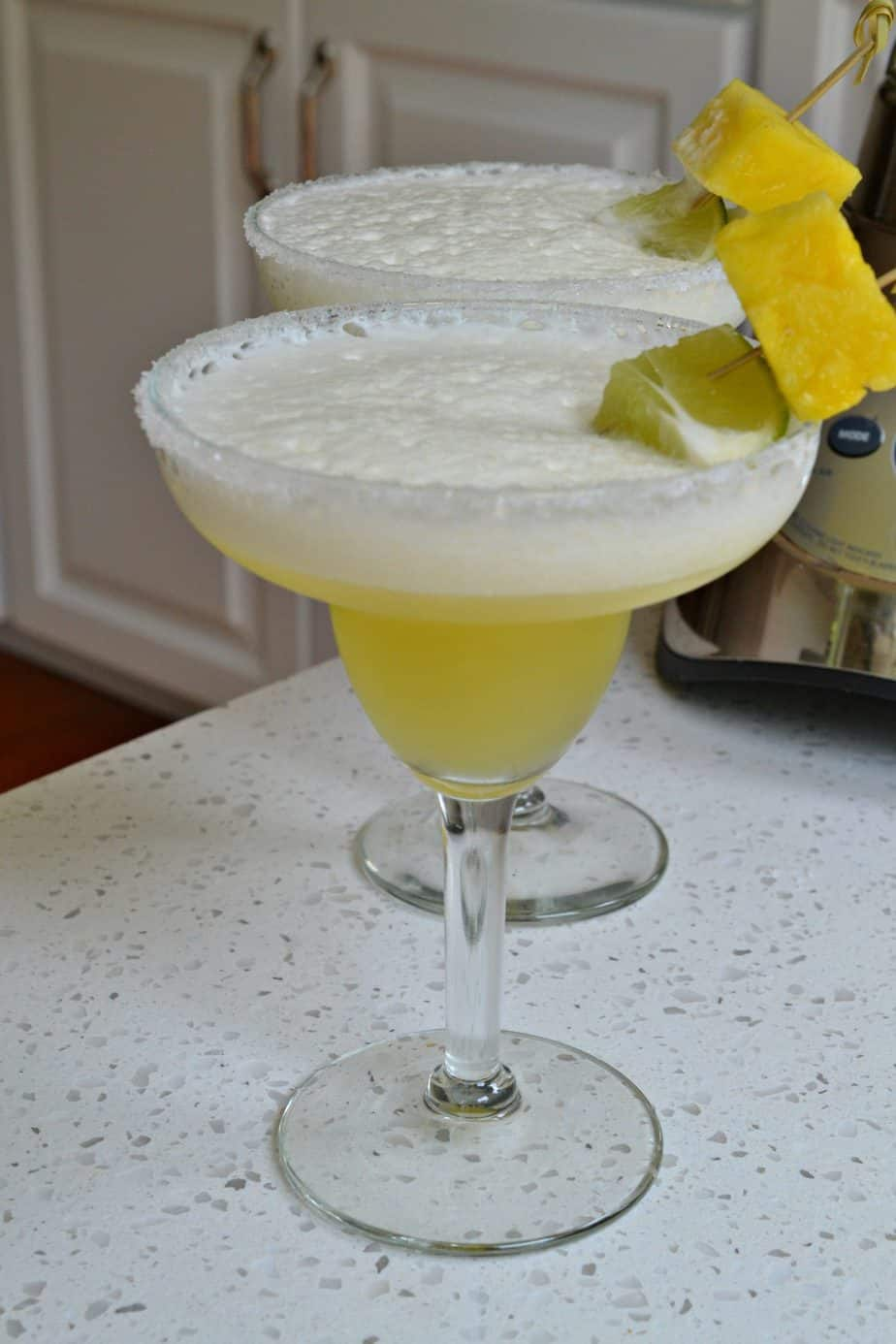 Pineapple Margaritas are one of our favorite entertaining cocktails and perfect for the summer.