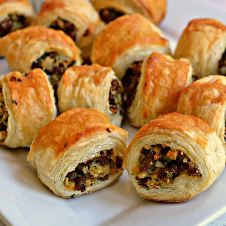 These sausage rolls combine buttery puff pasty stuffed with browned sausage, onion, a touch of Dijon mustard, and parsley.