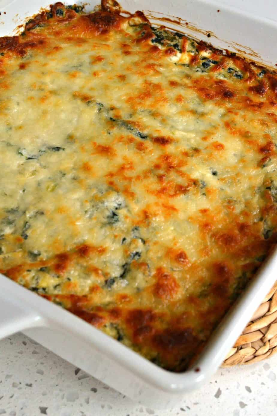A delicious fun and easy hot Spinach Artichoke Dip prepped in less than ten minutes.