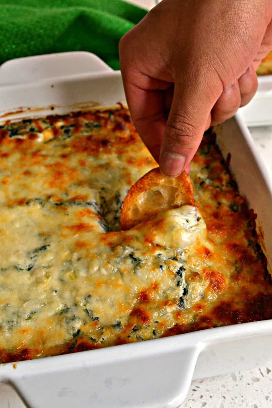 A super easy delectable cheesy spinach and artichoke party dip prepped in less than ten minutes.