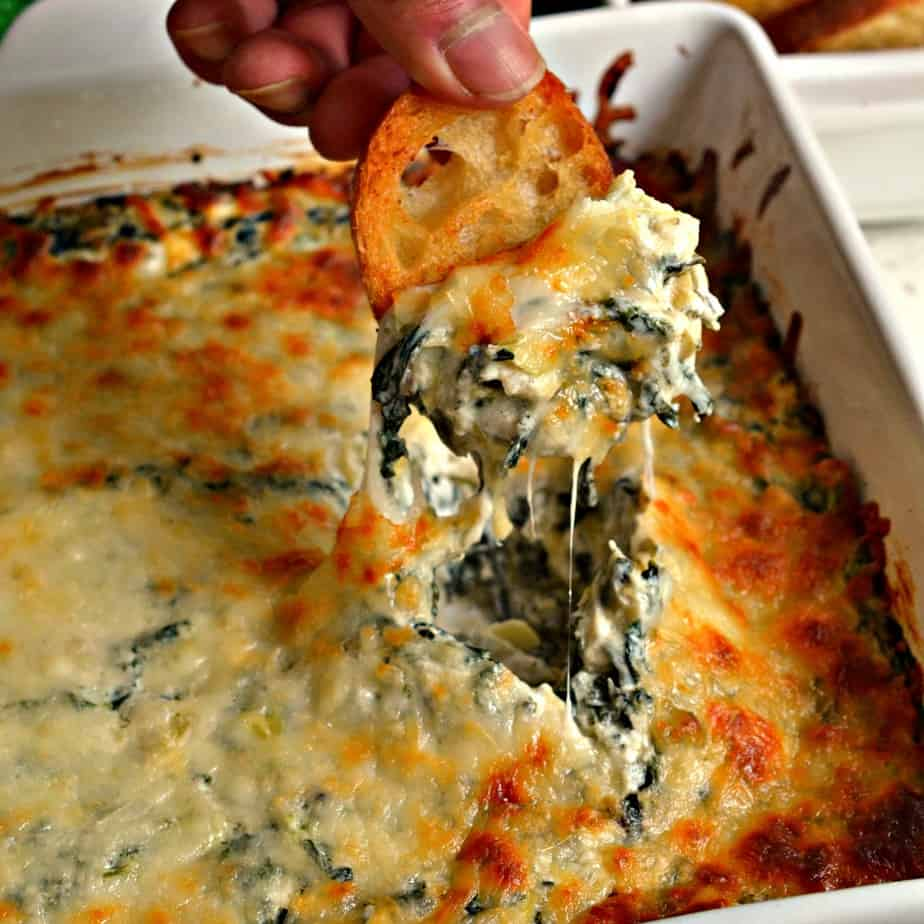 This Hot Spinach Artichoke Dip is a mouthwatering good hot mess that family and friends just love.