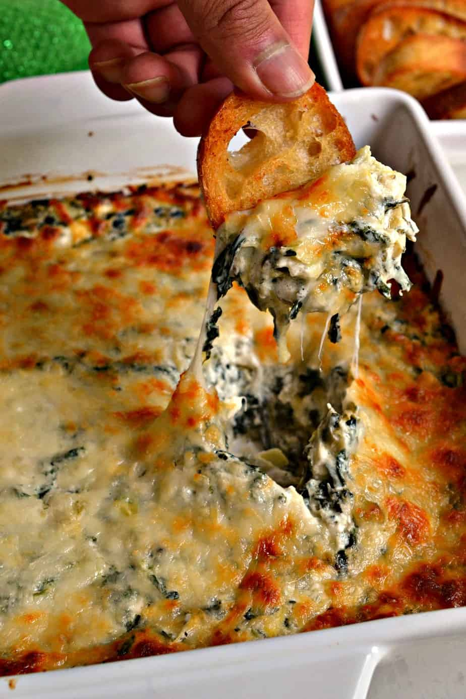 This Hot Spinach Artichoke Dip is a creamy cheesy delectable dip with garlic, Parmesan cheese, spinach and artichoke hearts.