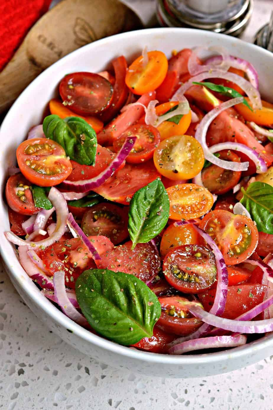 This Tomato Salad combines the best of summer's harvest with sun-ripened tomatoes, sweet red onions, garlic and fresh basil.