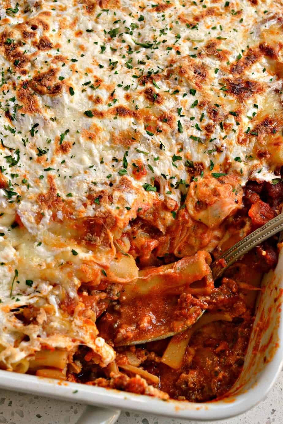 This Baked Ziti recipe is an easy friend and family favorite and serves quite a crowd.
