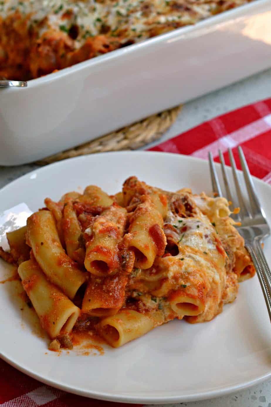 This Baked Ziti recipe is layered with Italian sausage, ricotta cheese, sweet marinara sauce and plenty of mozzarella.
