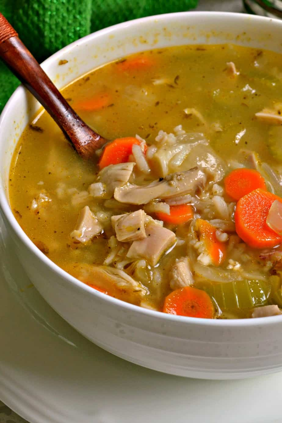 Delicious Chicken and Rice Soup full of carrots, celery, sweet onion, roasted chicken and tender white rice.