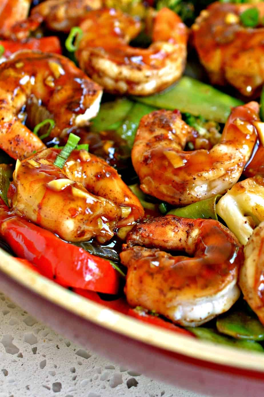 Garlic Shrimp Stir Fry brings together broccoli, snow peas, red bell pepper, onion and succulent shrimp in a honey garlic sauce.