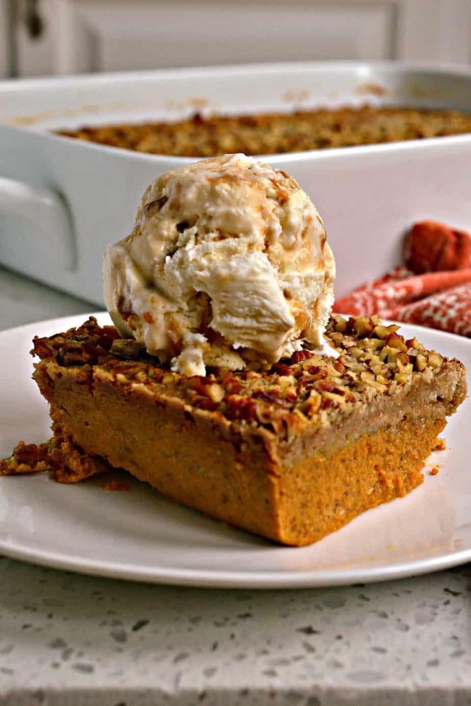 Pumpkin Dump Cake is a like a pumpkin pie with a sweet crunchy cinnamon pecan topping.