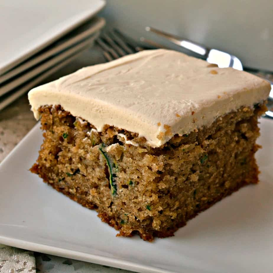 This delicious yet simple Zucchini Cake is made moist with fresh garden zucchini and walnuts.
