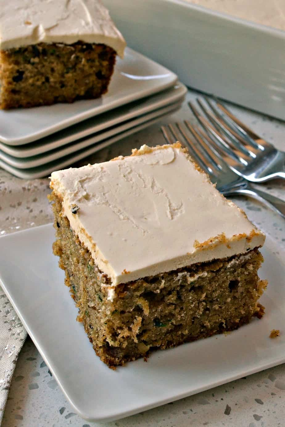 This scrumptious and moist zucchini cake is flavored with fresh zucchini, walnuts, cinnamon, nutmeg and allspice.