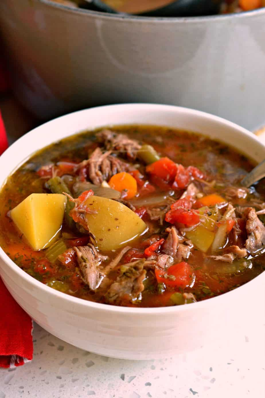 Beef Vegetable Soup is made with tender slow simmered chuck roast with celery, carrots, potatoes, tomatoes and green beans.