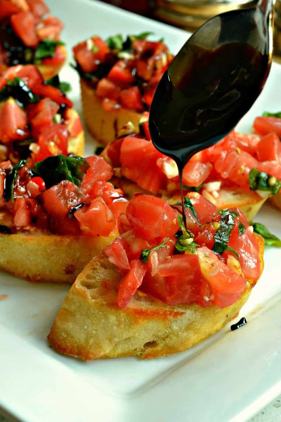 Sun ripened tomatoes, fresh basil, and sweet garlic combine in this easy Bruschetta recipe with a flavorful balsamic glaze.