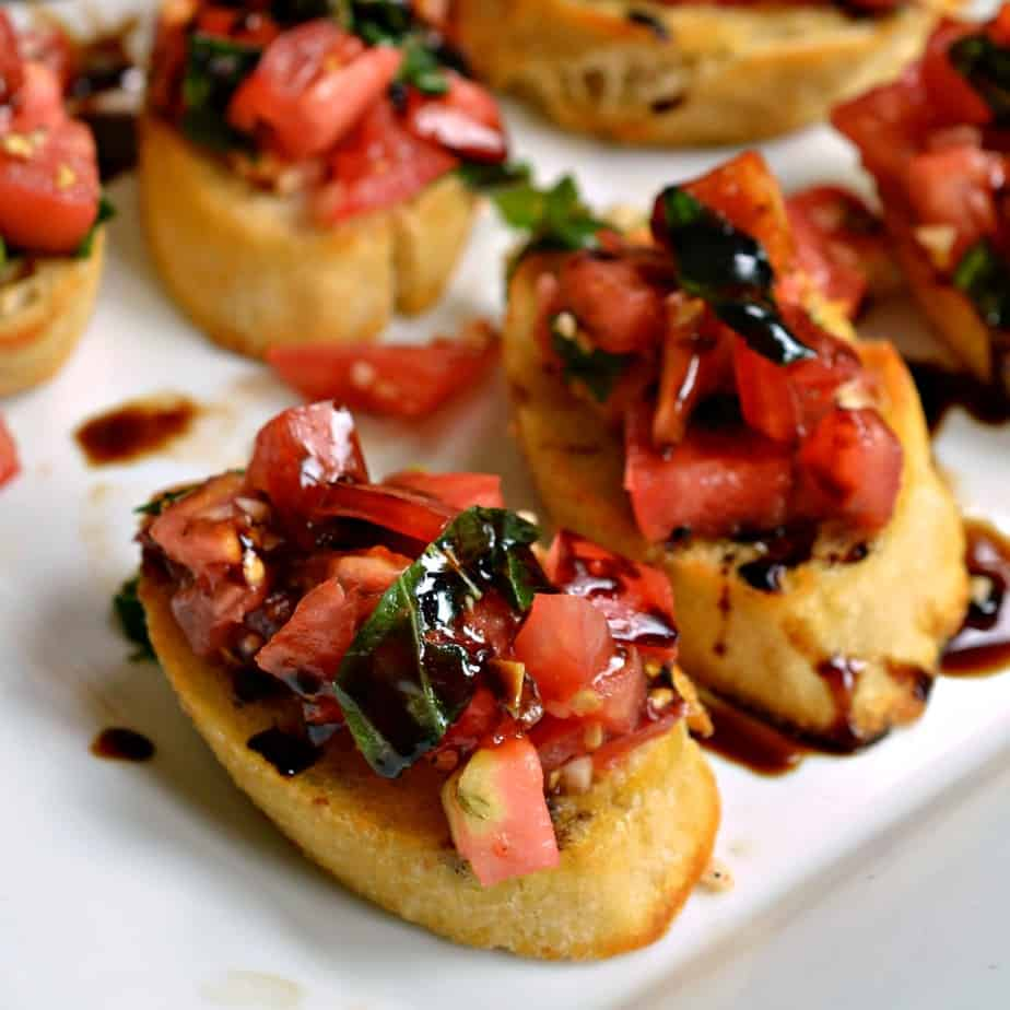 Fresh garden Bruschetta served on toasted baquette slices with a drizzle of balsamic glaze.