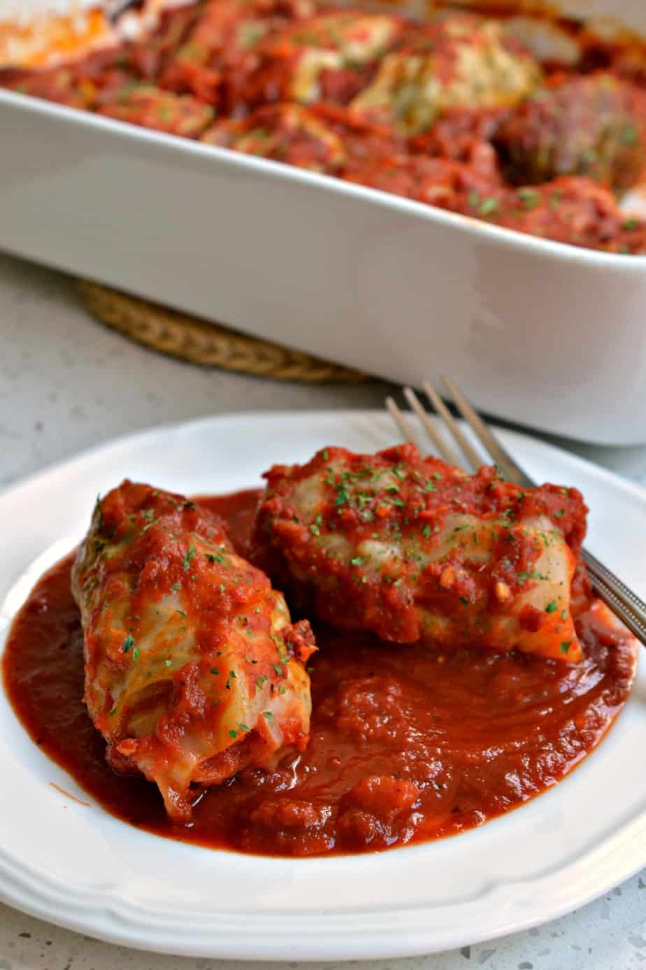 These traditional stuffed Cabbage Rolls are made with ground sausage and ground beef with a sweet and tangy tomato sauce.