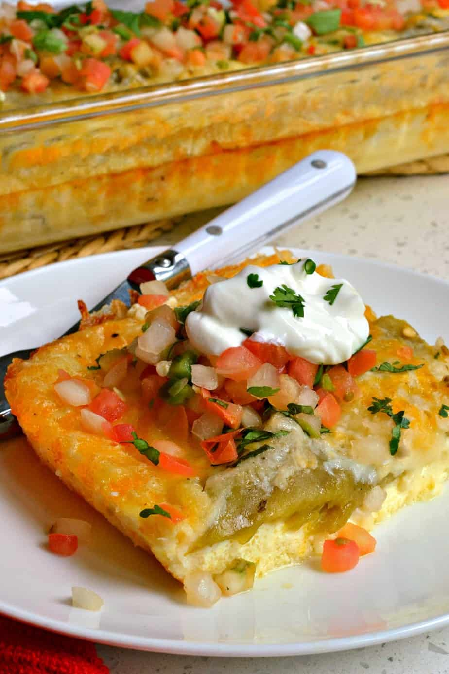 Egg and chile casserole piled high with pico de gallo and sour cream.