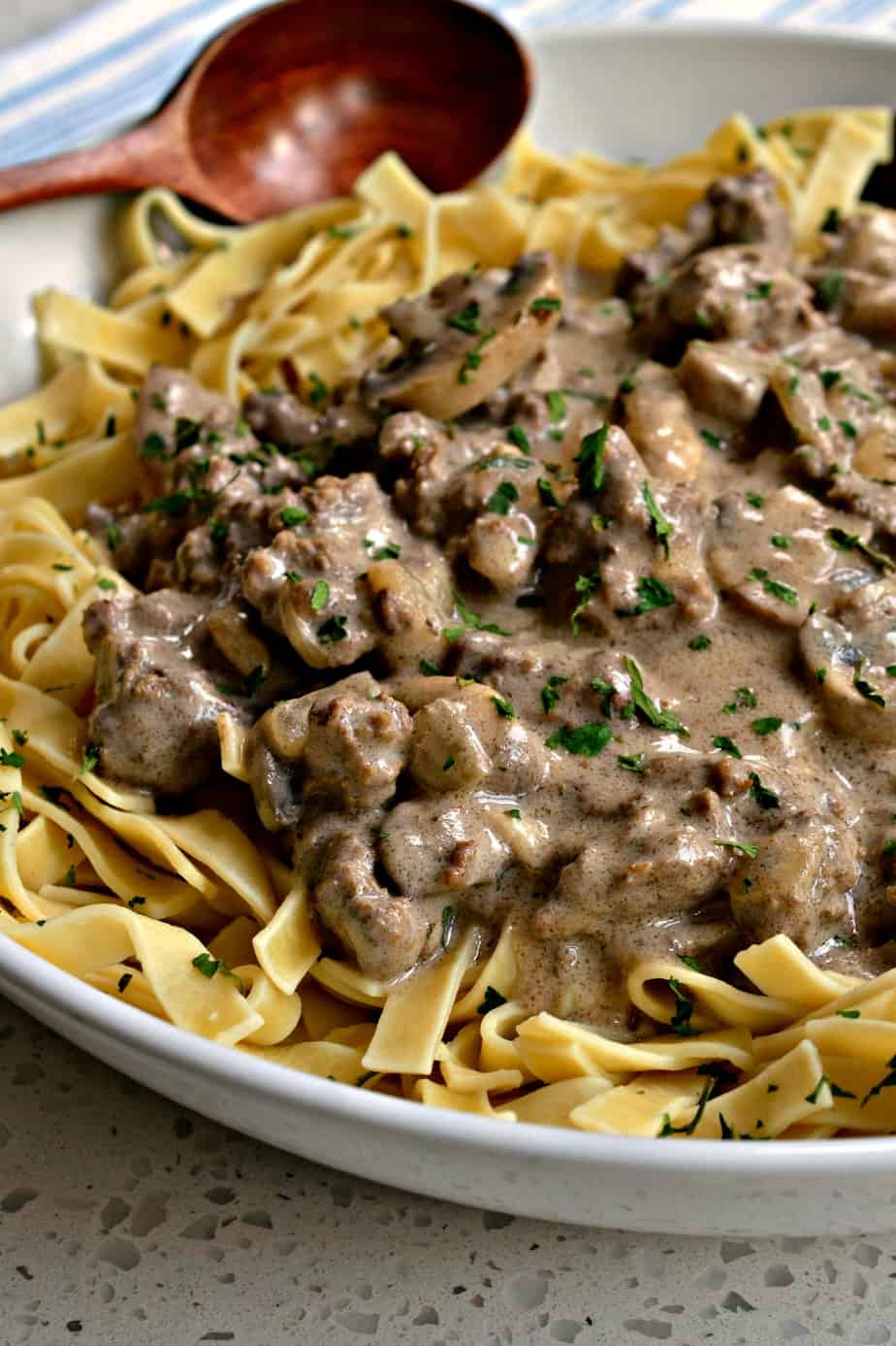 Ground Beef Stroganoff is made with mushrooms, onions, and garlic in a creamy rich gravy.