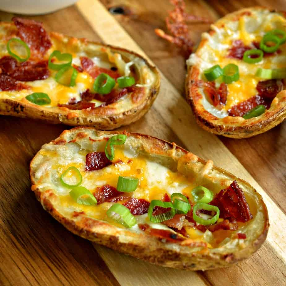 These extra crispy better than restaurant quality potato skins are topped with cheddar, Monterey Jack, bacon and onions.