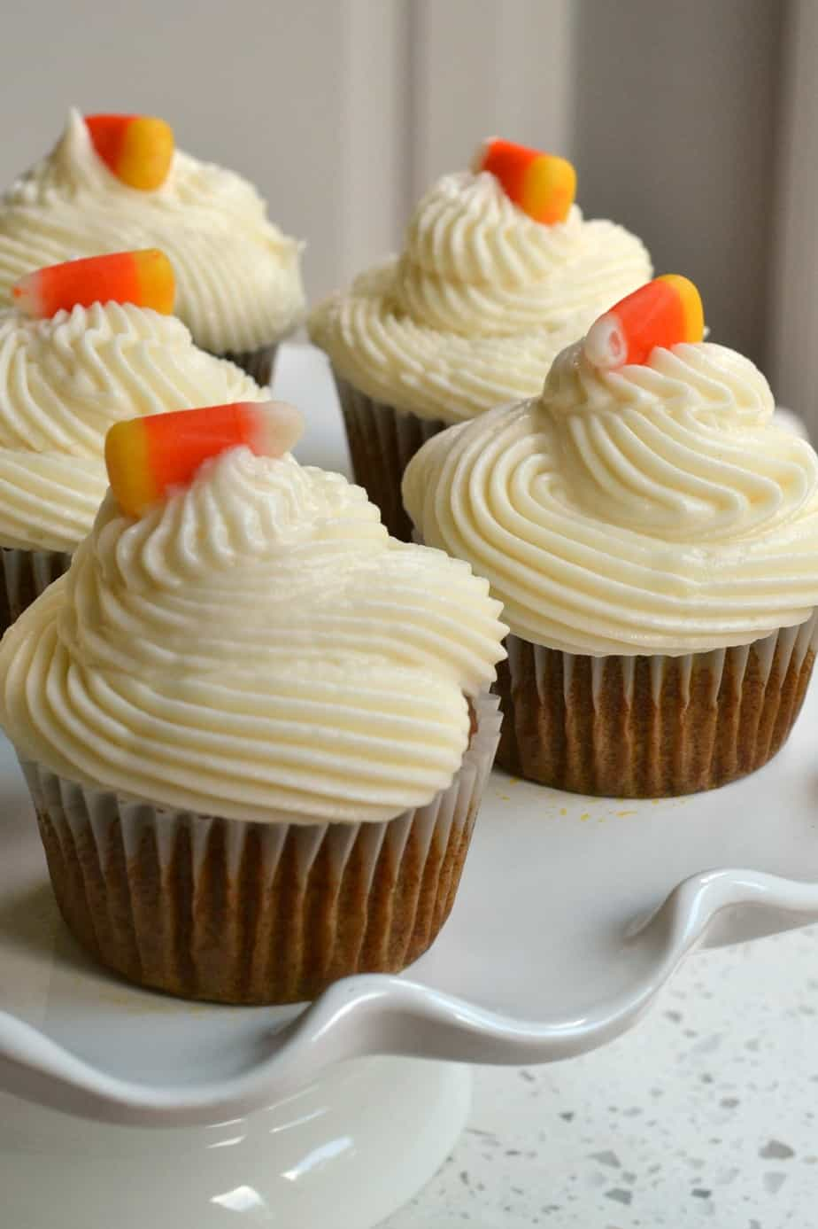 These adorable moist cinnamon pumpkin cupcakes are topped with an easy four ingredient cream cheese frosting.