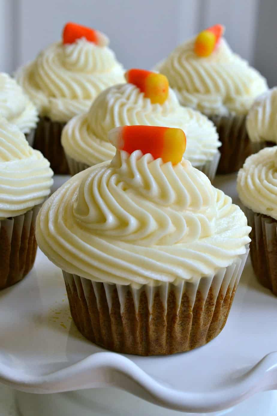 These Pumpkin Cupcakes are the perfect sweet treat, topped with a whipped cream cheese icing and candy corn