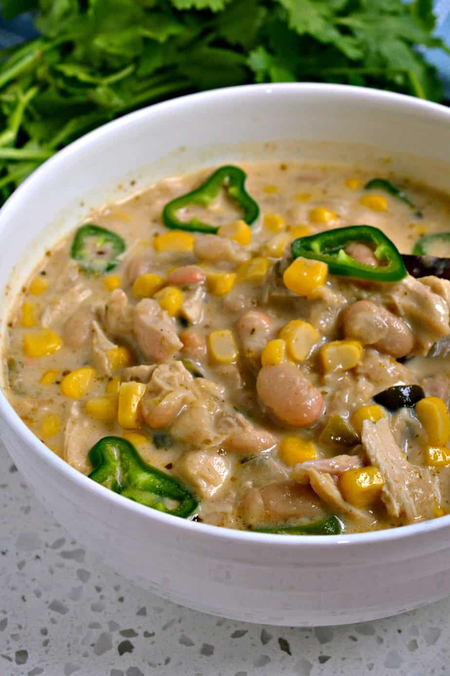 This creamy White Chicken Chili with fresh peppers is a nice change of pace from the traditional red tomato based chili.