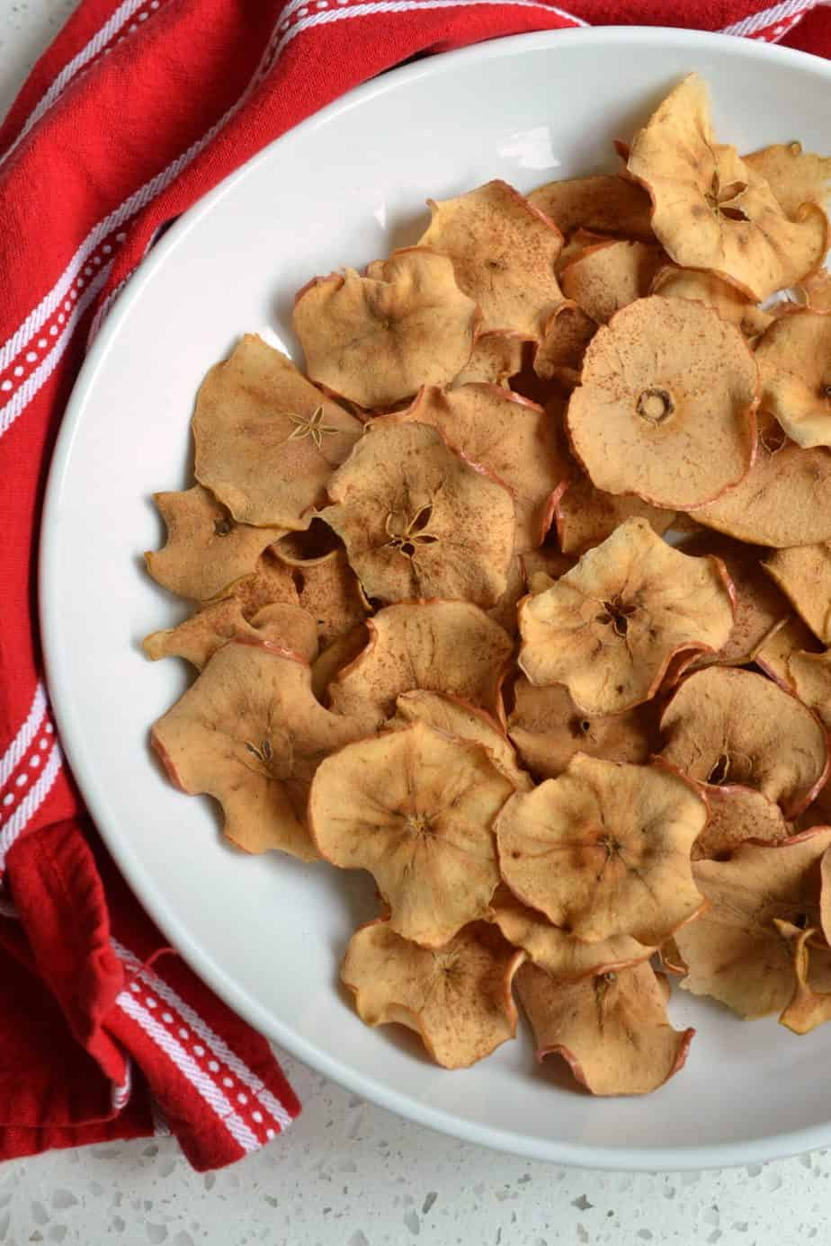 An easy healthy baked Apple Chip recipe that takes just minutes to prep and tastes delicious.