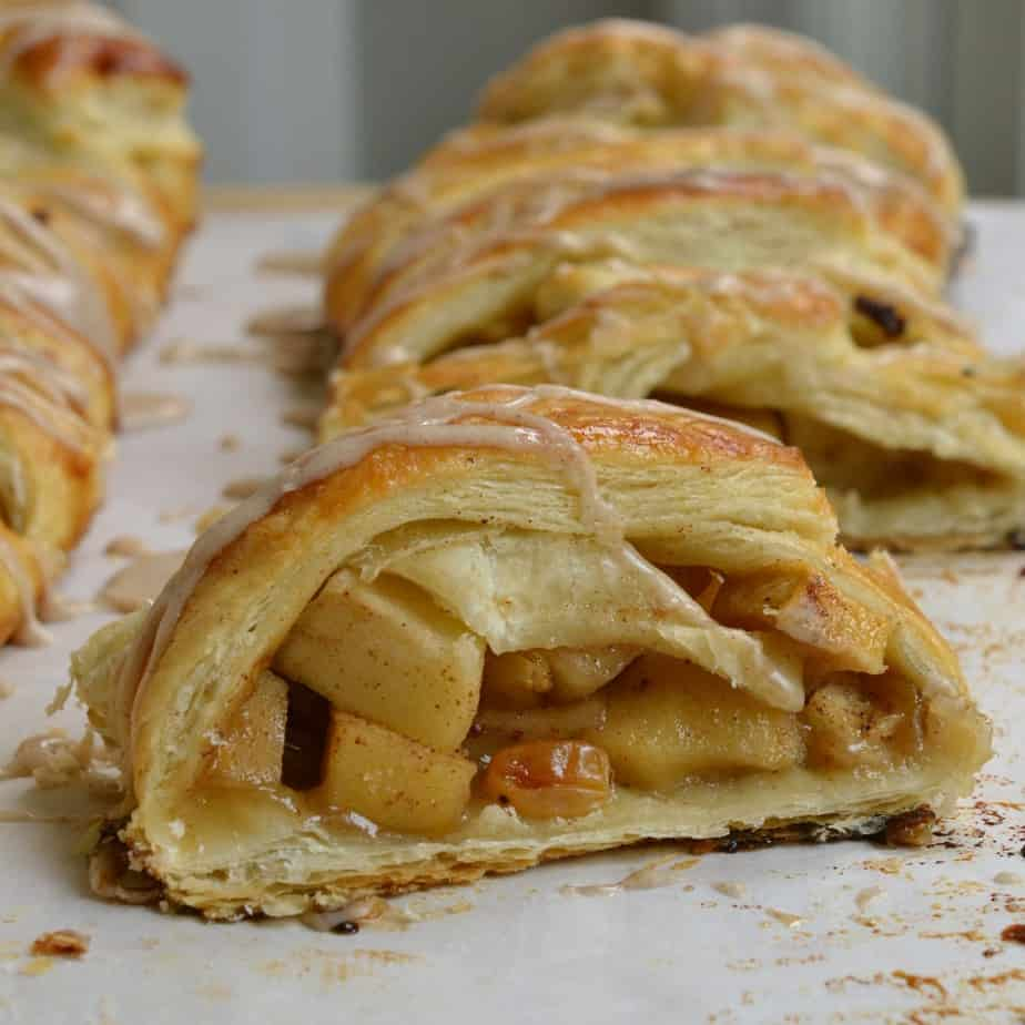 This Apple Strudel is made with flaky puff pastry, crisp apples, plump raisins all drizzled with a sweet cinnamon glaze.