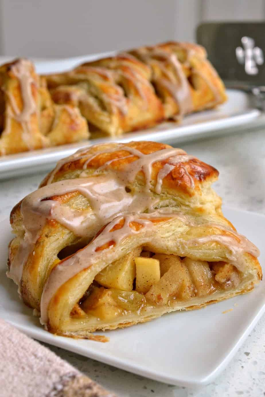This Apple Strudel is made with ready made puff pastry, fresh apples, raisins, and an easy four ingredient cinnamon glaze.