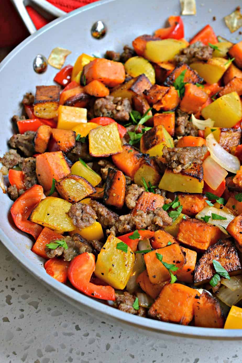 This hearty Sweet Potato hash has both sweet potatoes and gold potatoes, along with onions, bell peppers, and pork sausage.