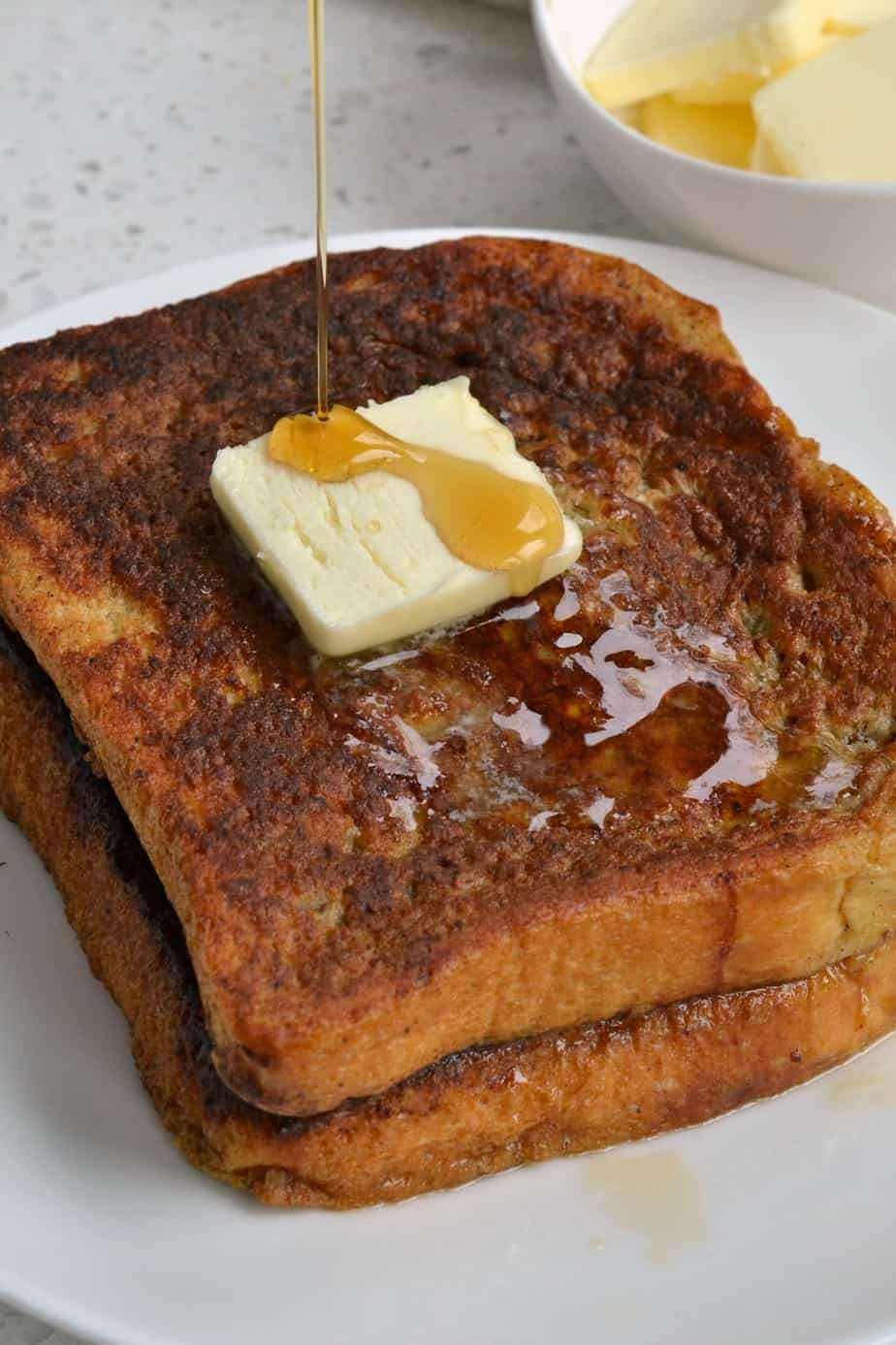 This easy French Toast recipe turns custard dipped bread slices into pure heavenly comfort.