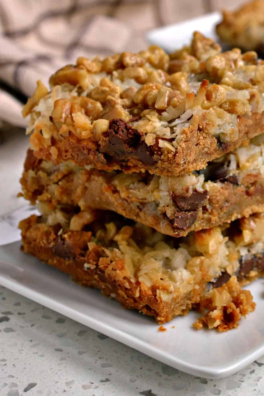 Fun, easy and delectable these Magic Cookie Bars will be a hit at your next party, potluck or family reunion.