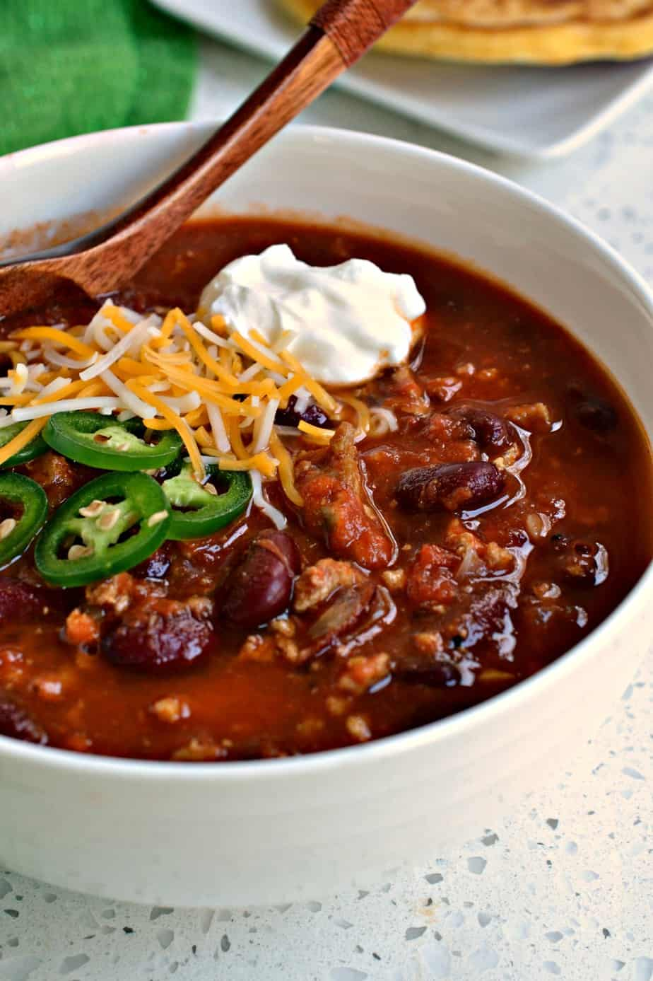 This Family Friendly Ground Turkey Chili is perfectly seasoned and slow simmered for a thick robust finish.