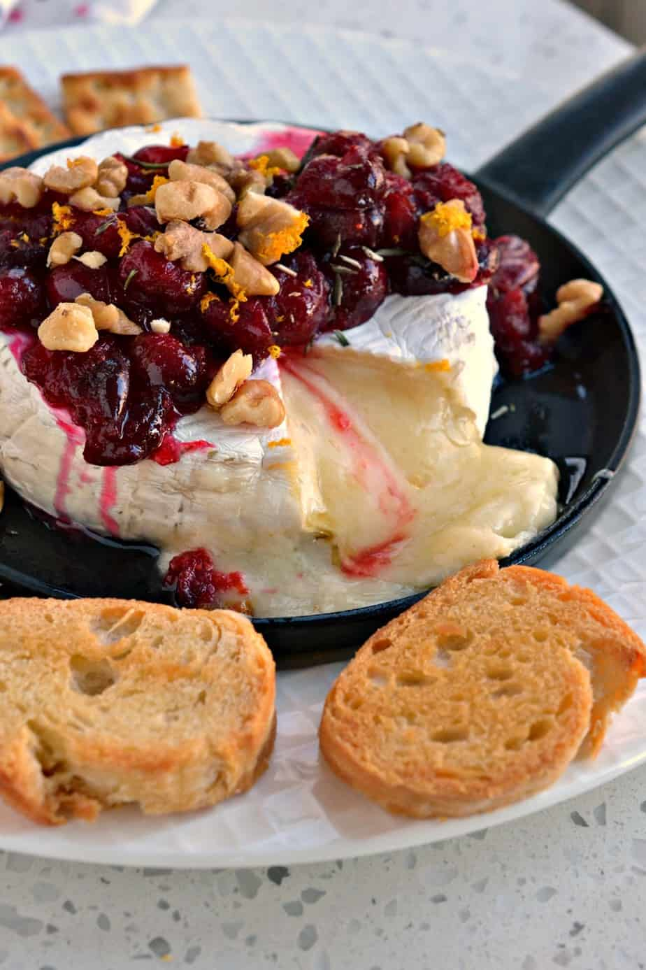 You will be so incredibly pleased with how easy this Baked Brie with Cranberries and Walnuts is and how delicious it tastes.