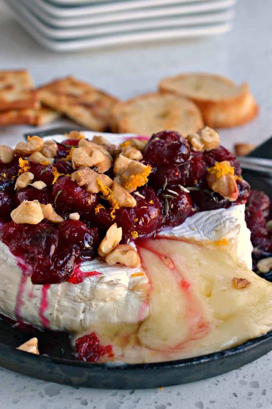 This Baked Brie with cranberries, walnuts, rosemary and honey is easy, elegant and flavorful.
