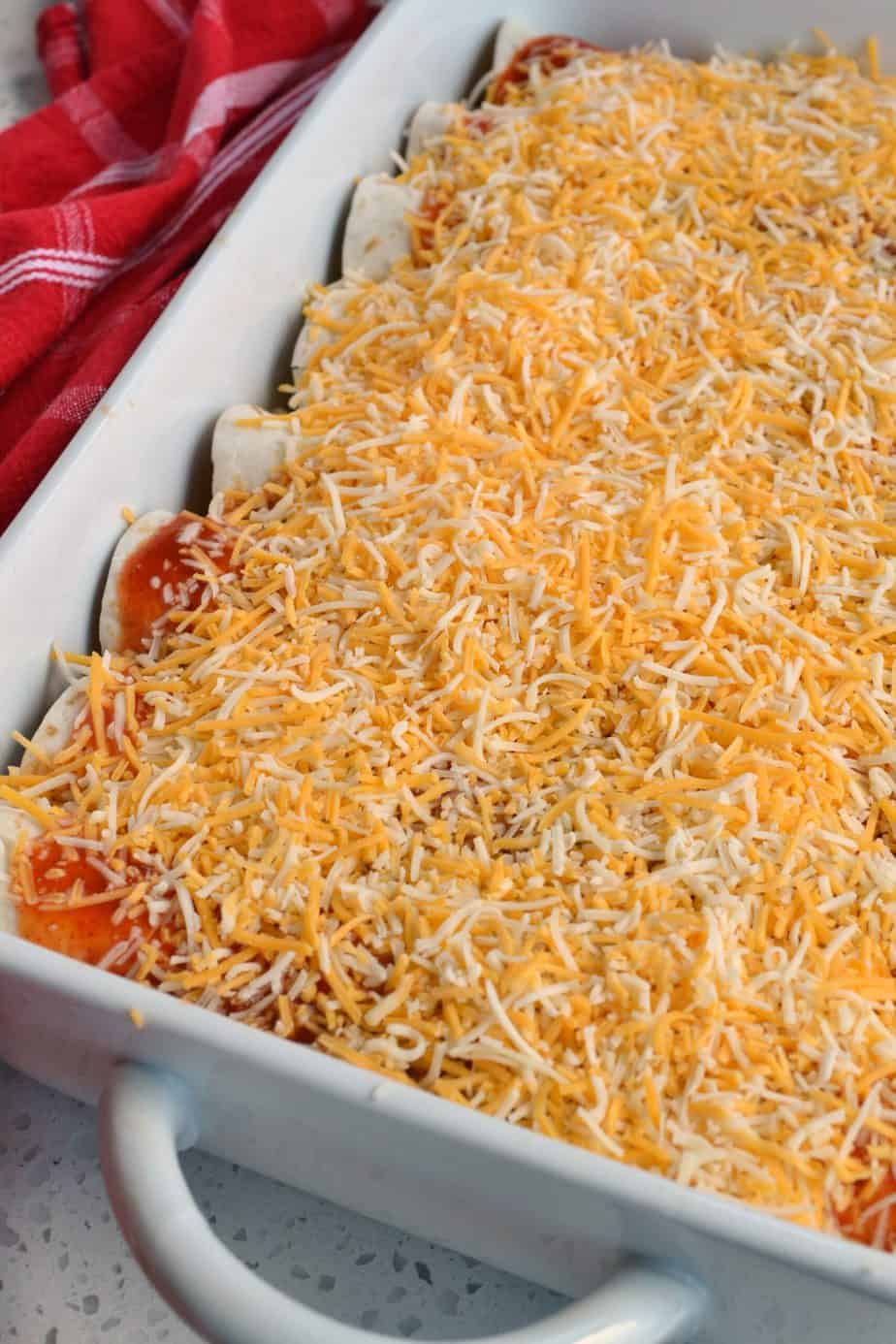 Fun and flavorful Tex Mex Chicken Enchiladas made with homemade enchilada sauce and already baked rotisserie chicken.