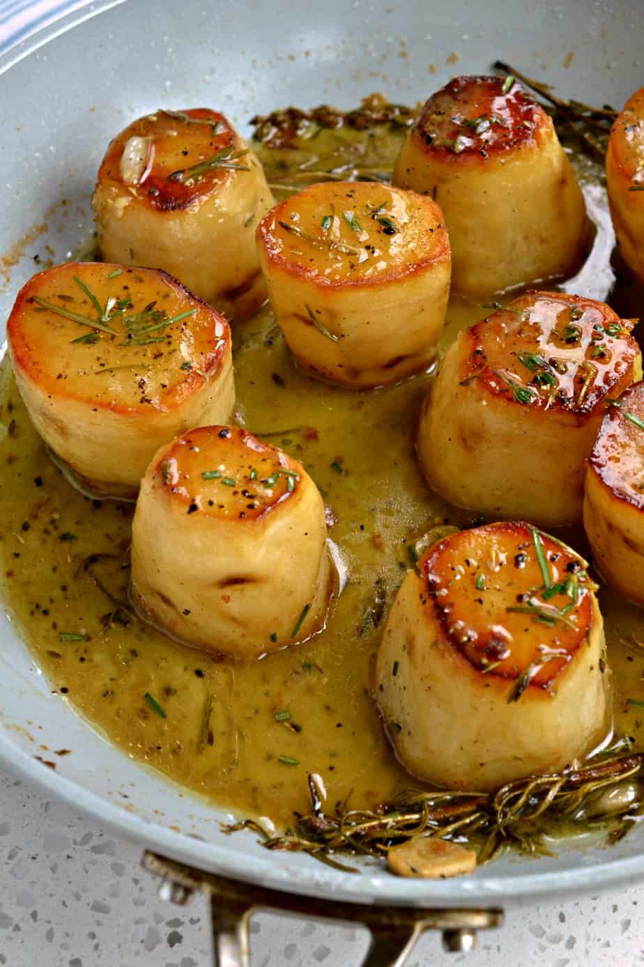 Easy yet elegant French Fondant Potatoes are tender baked with crispy edges in a buttery stock mixture with fresh herbs.
