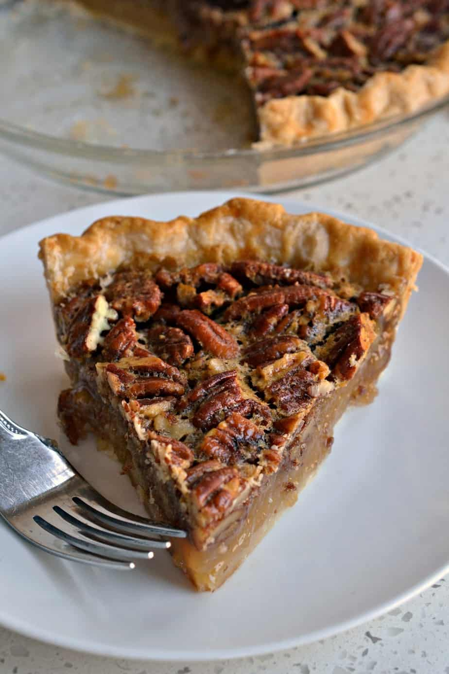 Southern Pecan Pie is a soft buttery mess of pecans nestled in soft sweetness made with eggs, brown sugar and butter.